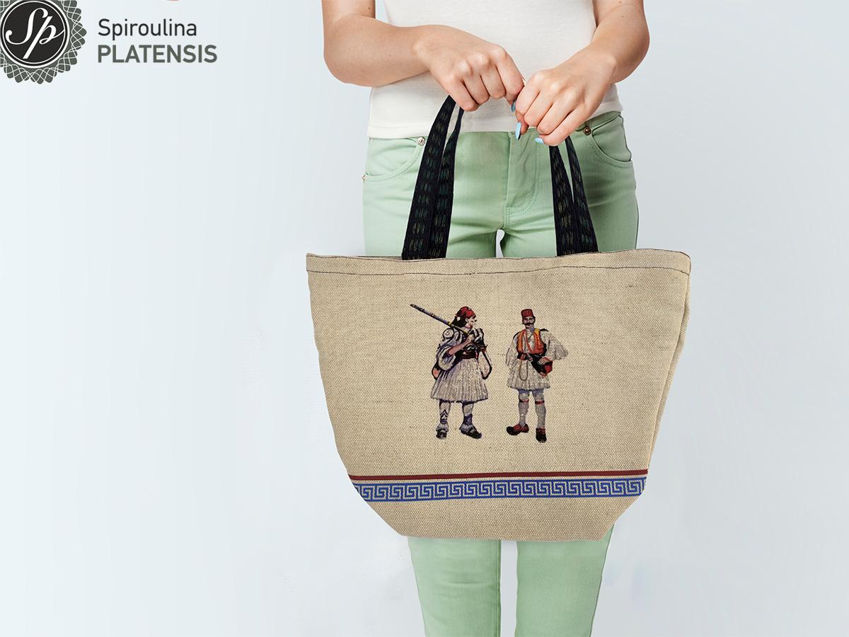 Γυναίκα που κρατάει την τσάντα Εύζωνες